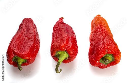 Fotografie, Tablou  red shriveled pepper on a natural white background