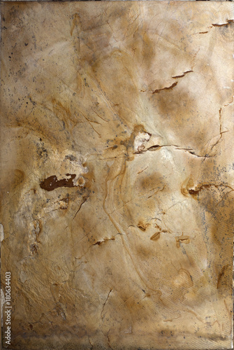 Photo Stands World Map Natural granite slab stone background texture.