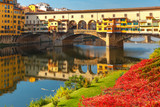 River Arno and famous bridge Ponte Vecchio in the sunny morning in Florence, Tuscany, Italy