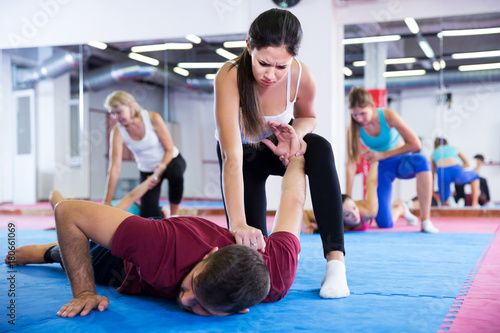 Girl is doing self-defence moves with coach