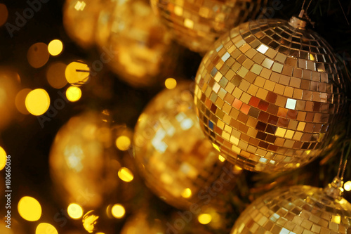 Fotografie, Tablou  close up mirror ball or Christmas ball to decorative for Christmas festival with bokeh golden tonebackground