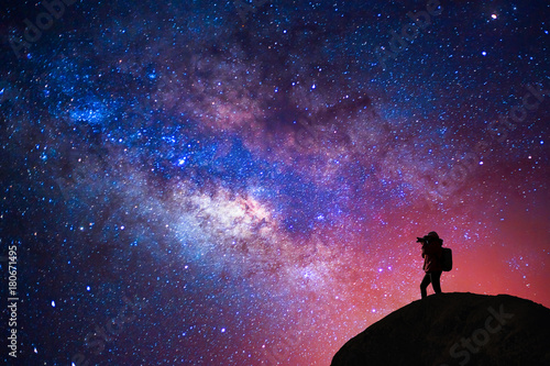 Silhouette of a camera girl who shooting a milky way Canvas Print