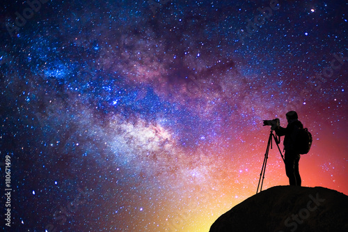 Vászonkép milky way, star, silhouette happy camera man on the mountain with detail of the