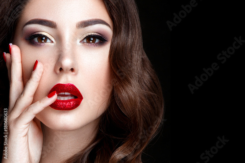 Fashion woman portrait on black background with red shiny lips. Poster