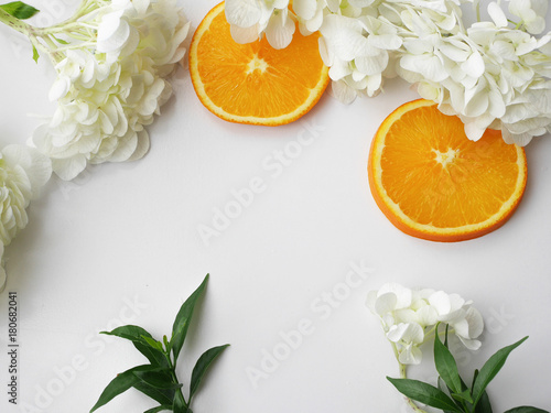 natural beauty background, orange, fruit,leaves,white flower on