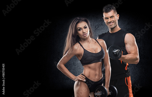 Fotografie, Obraz beautiful young sporty sexy couple showing muscle and workout in gym during phot