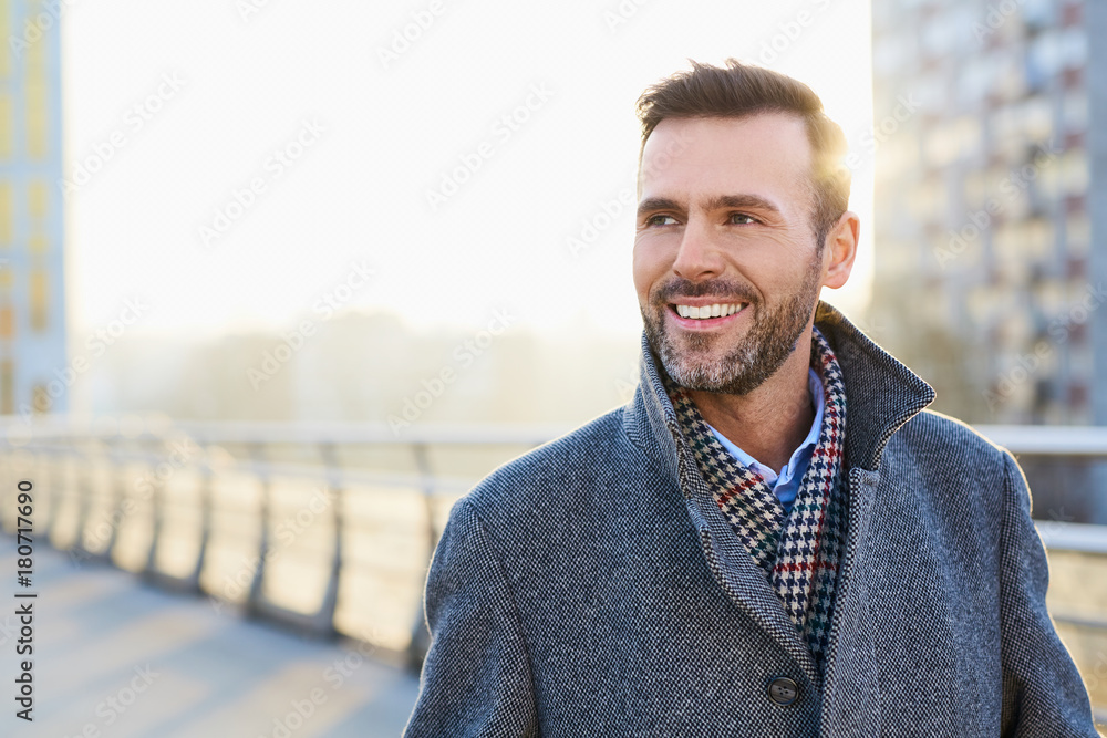 Fototapety, obrazy: Happy man standing outdoors during sunny winter day
