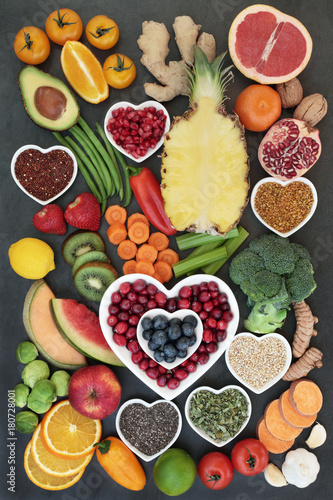 Health food for healthy eating concept with fruit, vegetables, seeds, nuts, tea, pollen grain, herbs and spices. High in omega 3 fatty acids, antioxidants, anthocyanins, fibre and vitamins.