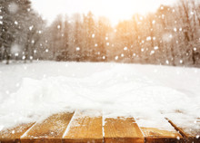 Wooden Desk Covered By Snow An...