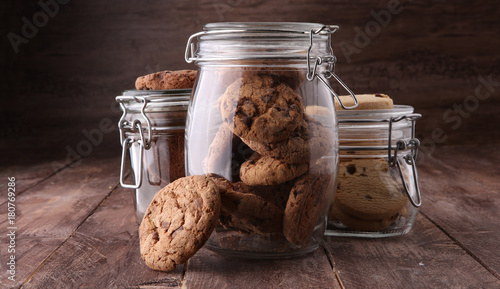 Leinwand Poster Chocolate cookies in a glass jar on white background.