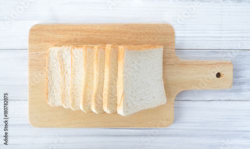 Fotografie, Obraz  Bread on white wooden table background from top view