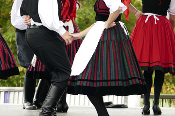 Hungarian folk dancers dancing in black, white and red.