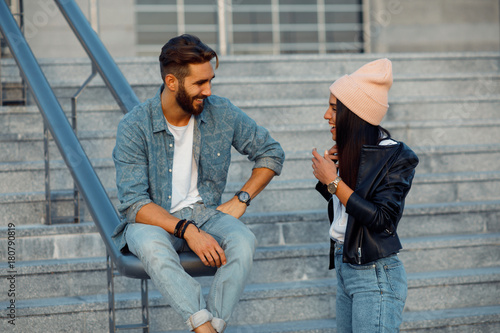 Young happy couple flirting outdoor Wallpaper Mural