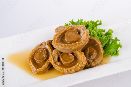 Photo Abalones. Chinese cuisine abalone on background.