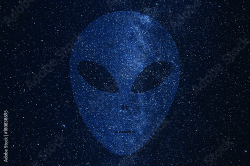 Photo  Alien face silhouette on background of Milky Way galaxy with glowing stars and planets in the universe