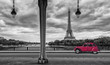 Eiffel Tower with vintage Car in Paris, seen from under the Bir Hakeim Bridge