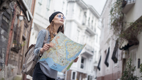 Fototapeta Young tourist woman hand map in outdoors obraz