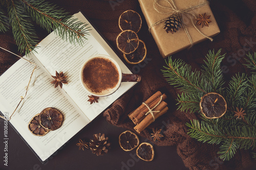 Spoed Foto op Canvas Chocolade Cup of hot chocolate and book with glasses on dark background