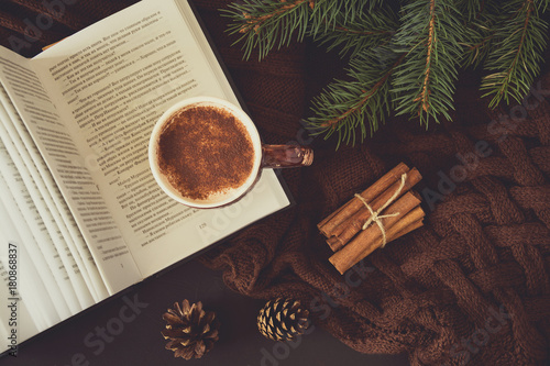 Spoed Foto op Canvas Chocolade Cup of hot chocolate, book and glasses on brown knitted background. Top view