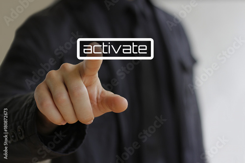 Businessman clicks on the activate button Canvas Print