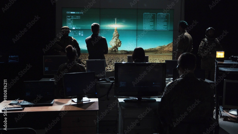 Fototapeta Authority man giving order to launch nuclear bomb and tracking it on digital screen.