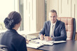 Businessman interview woman for work at office. Man working Concept. Vintage Tone.