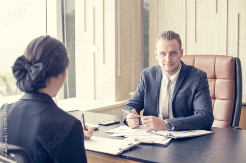 Fototapety, obrazy: Businessman interview woman for work at office. Man working Concept. Vintage Tone.