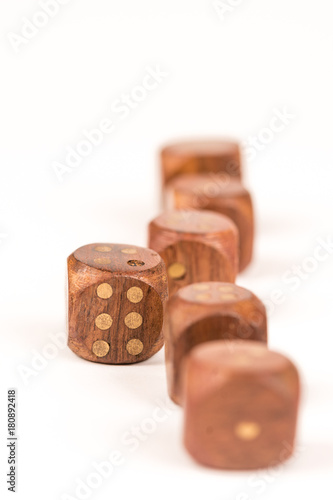 Foto  Selective focus on wooden gambling dice with individuality concept