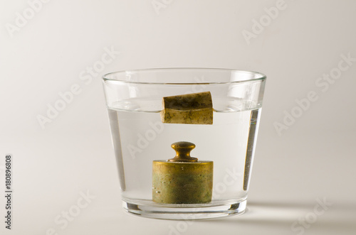 Photo Physics. Heavy and light objects in water.