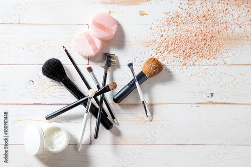Concept of cosmetics and makeup with powder, skincare and brushes Canvas Print