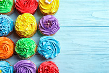 Tasty Colorful Cupcakes On Woo...