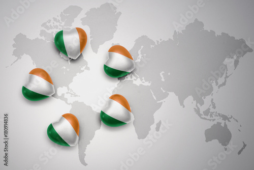 Photo  five hearts with national flag of ireland on a world map background