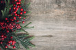 canvas print picture Christmas Evergreen Branches and Berries Over Rustic Wood Background