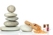 Set of spa with pyramid of stones and orange salt on white background