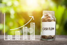Cash Flow Word With Coin In Gl...