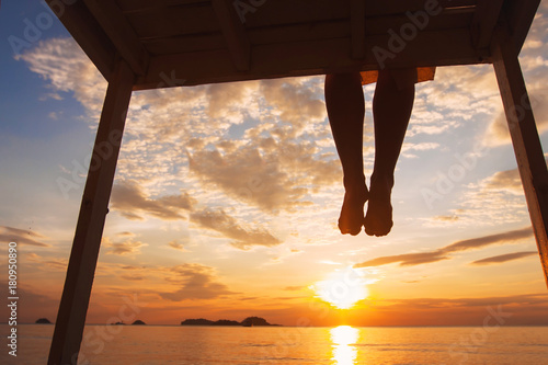 Fotografie, Obraz  mindfulness concept, woman enjoying summer evening on the beach at sunset, silho