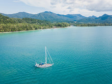 Sailing Boat Near Koh Chang Island In Thailand, Beautiful Aerial Paradise Beach Landscape From Drone