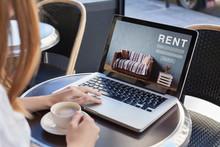 Rent Online Concept, Woman Usi...