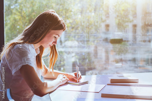 Fototapeta education, student girl in university during exam, young woman studying, people