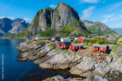Foto auf Leinwand Skandinavien Lofoten is an archipelago in the county of Nordland, Norway. Is known for a distinctive scenery with dramatic mountains and peaks, open sea and sheltered bays, beaches and untouched lands.