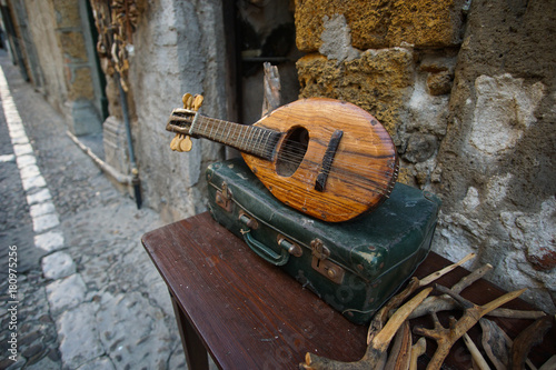 Photo Old worn lute with case