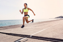 Young Woman Running Outdoors, ...