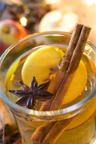 Spoed Foto op Canvas Chocolade Close up mulled cider in glass on wooden table. Christmas drink
