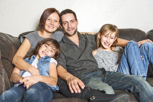 Portrait of family having fun in the living room Fototapete