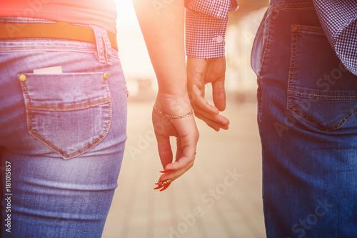 Valokuva  Hands closeup of a loving couple, romance, love, jeans