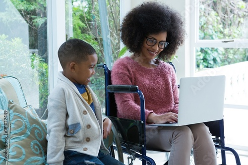 Obraz Son and his disabled mother using laptop - fototapety do salonu