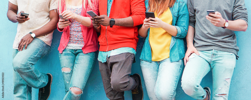 Fototapety, obrazy: Group of young friends watching smart mobile phones