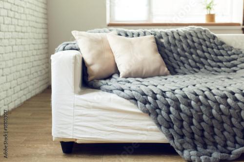 Obraz Grey knit giant plaid with pillows - fototapety do salonu