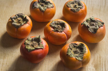Top View Of Persimmons On Cutt...