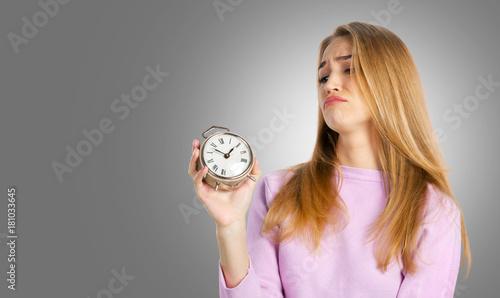 Fotografie, Obraz  woman holding alarm clock